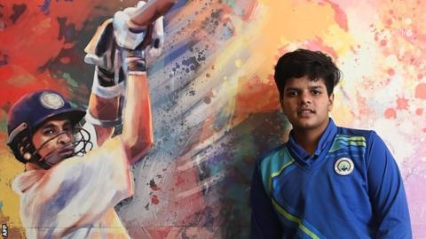 Shafali Verma next to a portrait of India legend Sachin Tendulkar