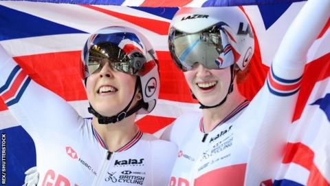 Sophie Thornhill and pilot Helen Scott hold a British flag aloft after winning gold in the women's tandem 1km time trial