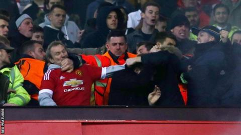 Stewards had to step in as trouble flared between fans at Old Trafford