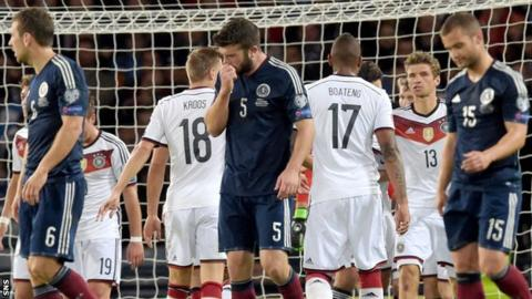 Scotland players show their disappointment as they lost 3-2 to Germany
