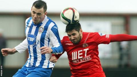 Coleraine's Darren McCauley challenges Portadown midfielder Sean Mackle