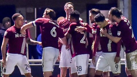 Northampton players celebrate Shay Facey's goal