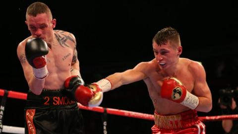 Jason Booth takes evasive action in the bout against Ryan Burnett
