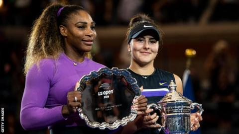 Serena Williams and Bianca Andreescu pose for photographers with their US Open trophies