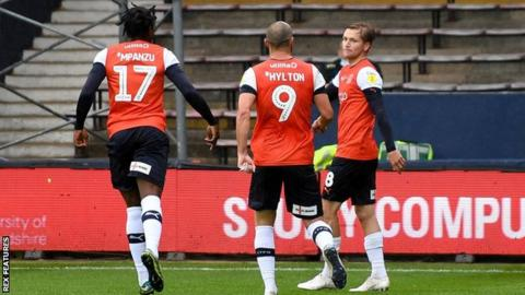 Luke Berry (right) celebrates his goal for Luton