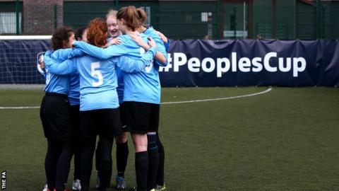 Girls football team huddle