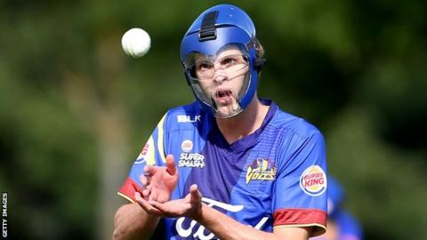 Otago Volts bowler Warren Barnes wears a protective mask during a match