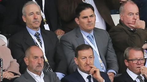 Huw Jenkins (front centre) seated in front of Stephen Kaplan and Jason Levien