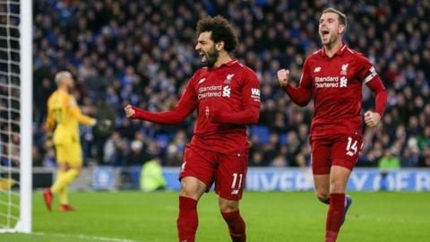 Liverpool celebrate scoring against Brighton