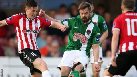 Aaron McEneff tries to win the ball for Derry City against Cork's Greg Bolger