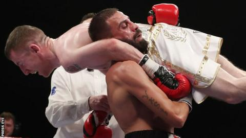 Stefan Slavchev was disqualified for lifting Barnes off his feet as the Belfast boxer made his pro debut