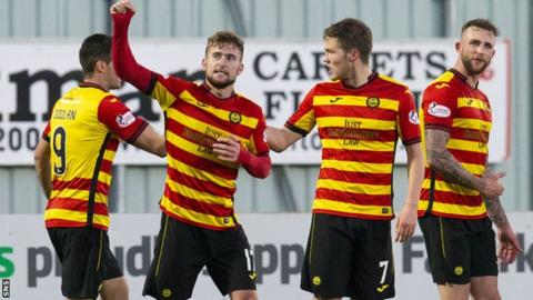 Partick Thistle's Craig Slater (centre) celebrates after firing his side ahead.
