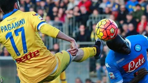 Napoli defender Kalidou Koulibaly heads the ball away from Frosinone forward Luca Paganini's boot.