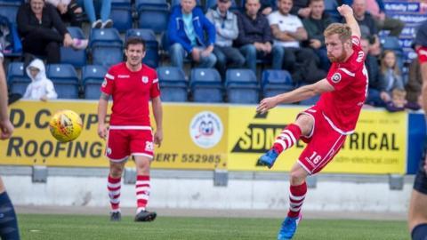 Jay Owen has an effort on goal for Connah's Quay