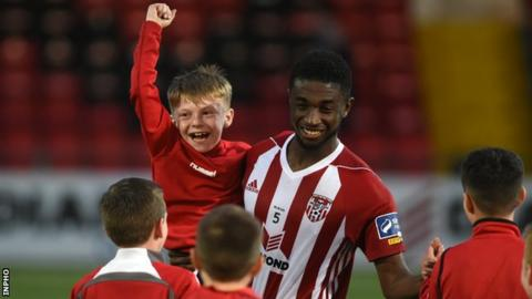 Junior celebrates with young Derry fans after Friday's game