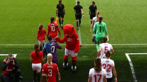 Manchester United Women and Liverpool Women walk out at Leigh Sports Village