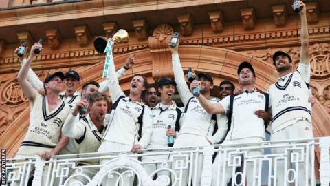 Middlesex's players celebrate winning the County Championship title