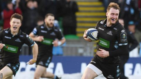 Stuart Hogg races in to score a try for Glasgow