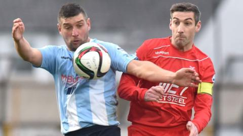 Matthew Tipton and Keith O'Hara contend for possession as Ballymena United draw 1-1 with Portadown at the Showgrounds