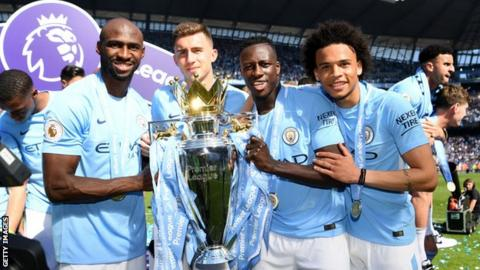 Eliaquim Mangala, Aymeric Laporte, Benjamin Mendy and Leroy Sane with the Premier League trophy in May 2018