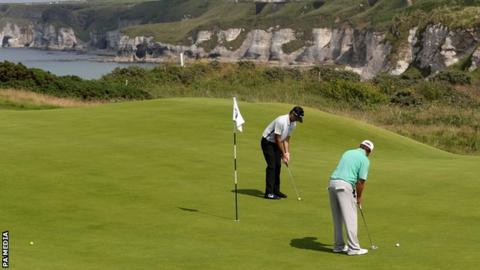 American pair Bubba Watson and JB Holmes on the fifth green at Royal Portrush