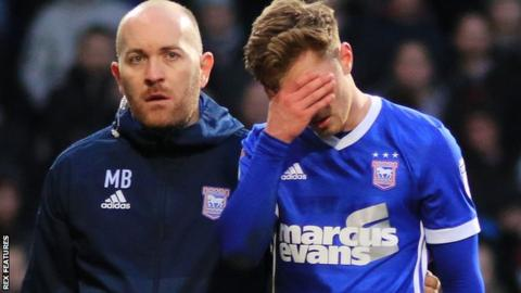 Ipswich midfielder Teddy Bishop had to be substituted against QPR