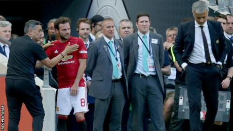 Substitute Juan Mata looks unhappy after being substituted during Manchester United's Community Shield win over Leicester City