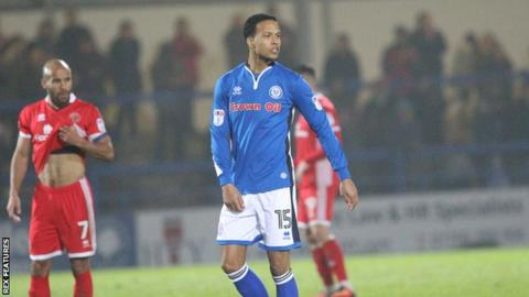 Joe Thompson looks on after taking to the field for Rochdale against Walsall
