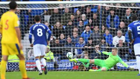 Jordan Pickford saves a penalty for Everton