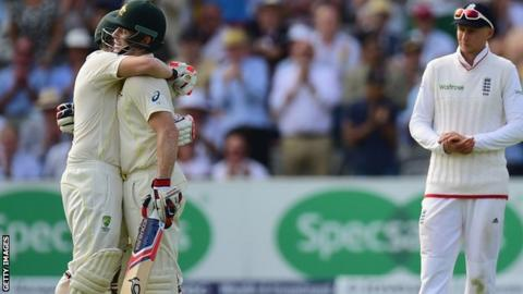 Chris Rogers and Steve Smith embrace