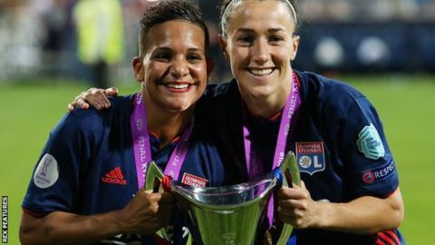 Shanice van de Sanden and Lucy Bronze of Lyon celebrate with the Women's Champions League trophy
