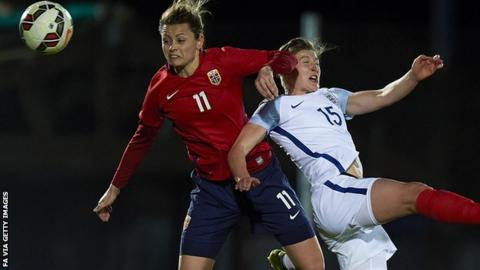 Nora Holstad of Norway competes for the ball with Ellen White of England