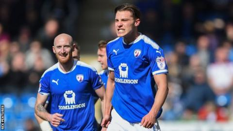 Chesterfield defender Sid Nelson celebrates scoring the opening goal against Notts County