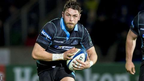 Roger Wilson runs with the ball for Glasgow