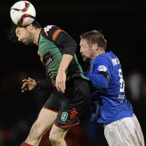 Curtis Allen beats Glenavon skipper Kris Lindsay to the ball during Glentoran's 2-0 win at the Oval
