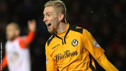Oliver McBurnie celebrates his second goal for Newport