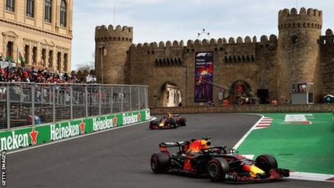 Max Verstappen and Daniel Ricciardo drive past the medieval castle in the city of Baku