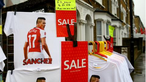 Alexis Sanchez t-shirts on sale outside the Emirates stadium