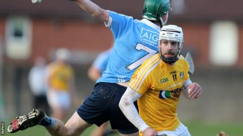 Neil McManus (right) battles with Dublin's James Madden at Corrigan Park earlier this month