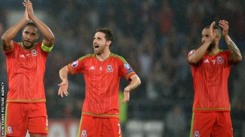 Ashley Williams, Joe Allen and Jazz Richards celebrate Wales' win over Belgium