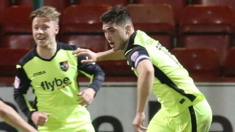 Jordan Moore-Taylor celebrates after scoring Exeter's equaliser