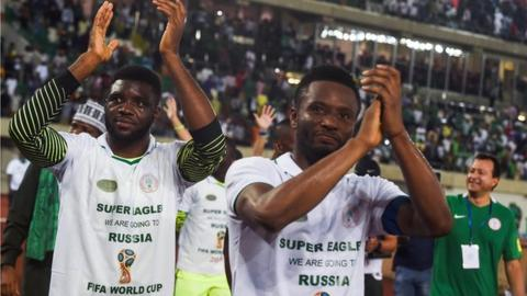 Captain John Mikel Obi applauds Nigerian fans after securing a World Cup place on Saturday