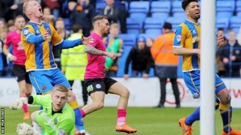 Jon Taylor of Peterborough United scores the winning goal
