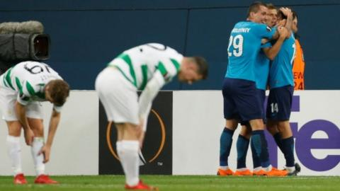 Zenit St. Petersburgs Aleksandr Kokorin celebrates scoring their third goal as Celtic players look dejected