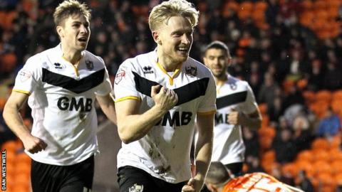 AJ Leitch Smith celebrates his winner against Blackpool