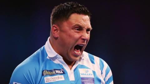Gerwyn Price celebrates against Nathan Aspinall