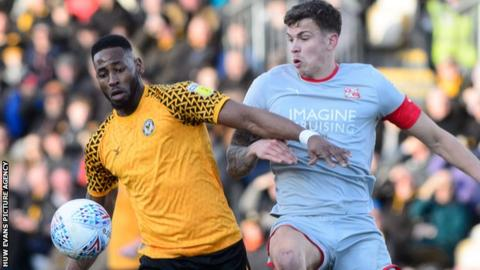Newport's County Jamille Matt in action against Swindon's Tom Broadbent