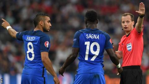 Dimitri Payet and Bacary Sagna of France with referee Willie Collum