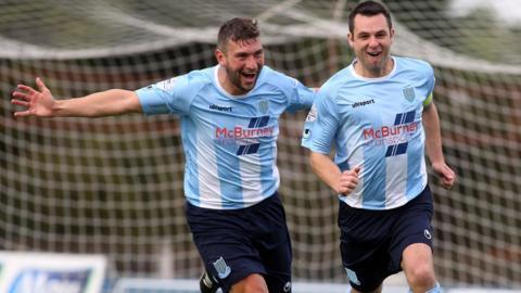 Ballymena hat-trick penalty hero Matthew Tipton congratulates skipper Jim Ervin after the defender scored his side's fifth goal