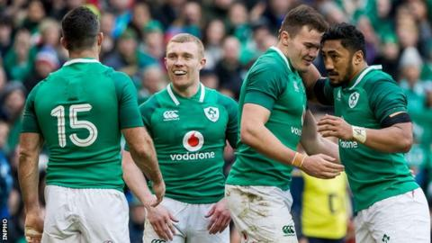 Stockdale is congratulated by Rob Kearney (15), Earls and Bundee Aki (right) after one of his two tries against Italy